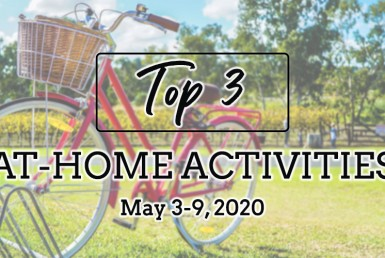 Top 3 At-Home Acitivites: May 3-9, 2020. Red bike, green grass, blue sky.