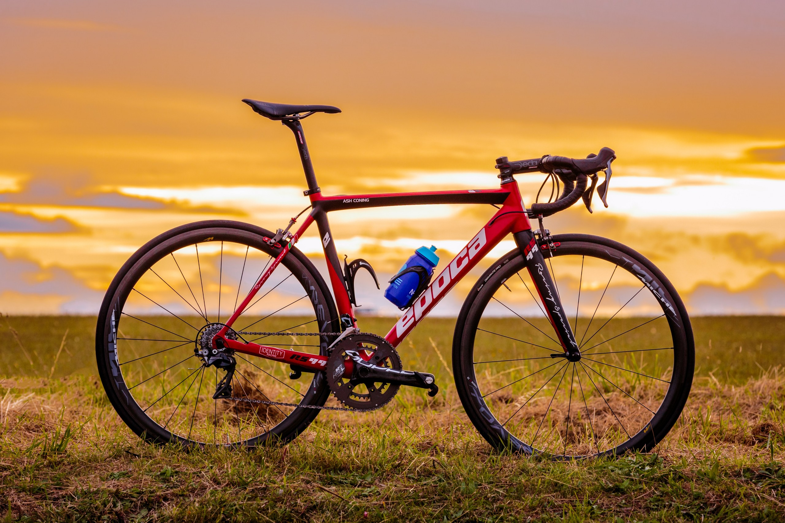 Bike on grass. Sunrise.