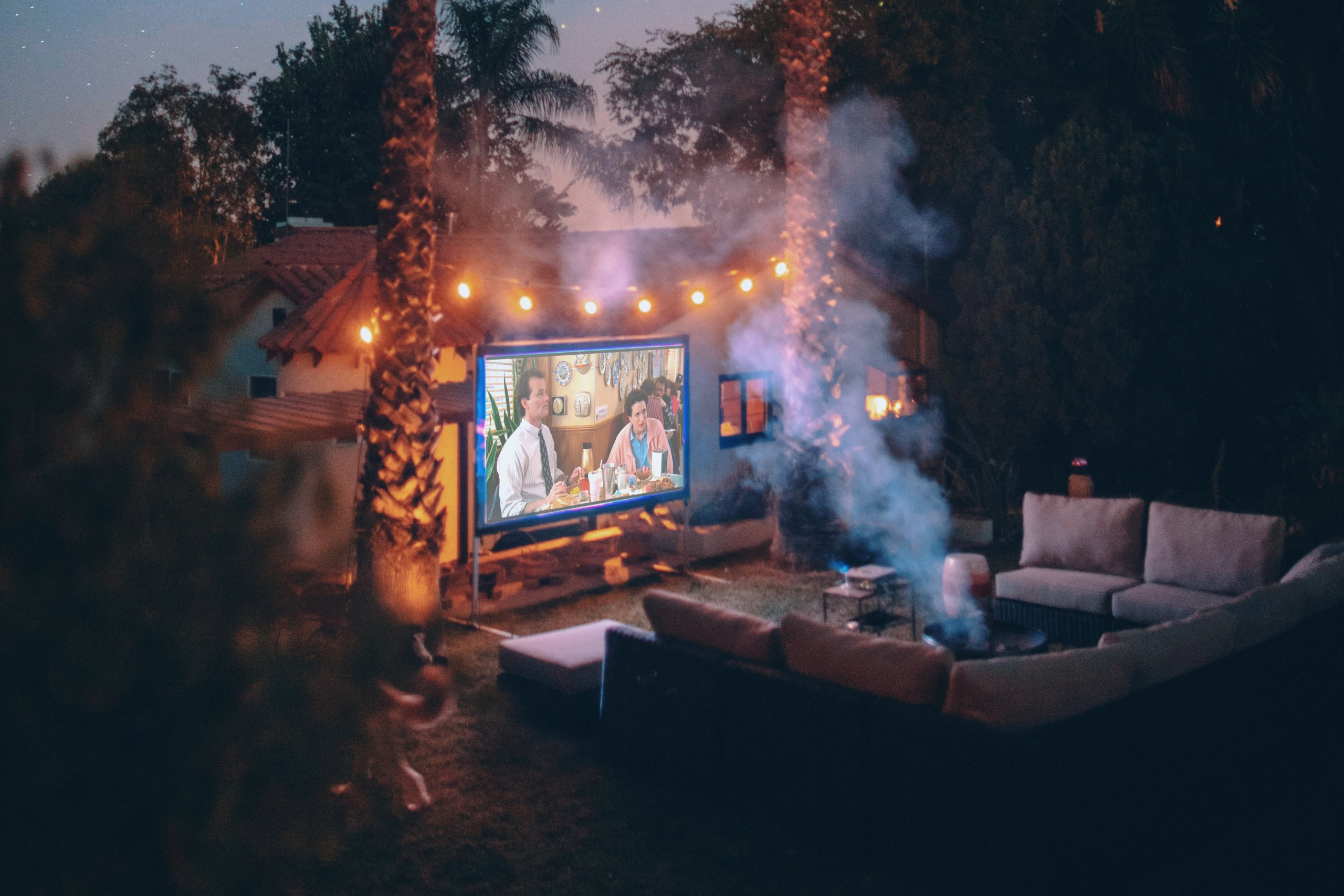 Movie Screen in backyard with Couch.
