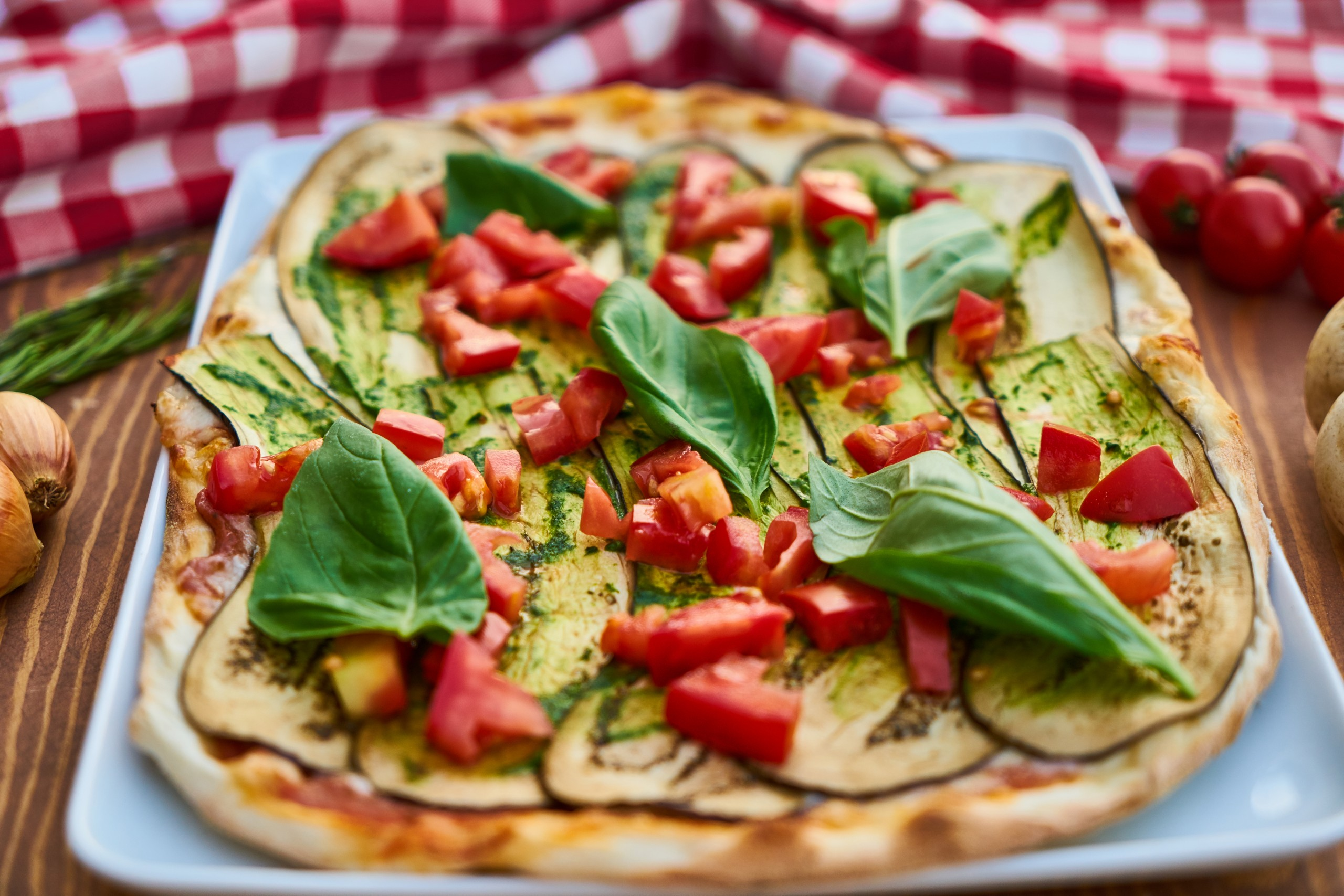 Flatbread Pizza with tomatoes and eggplant.