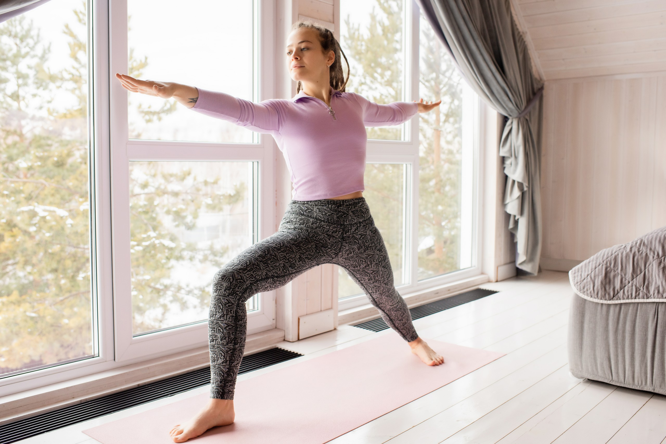 Woman doing Yoga Pose in Home