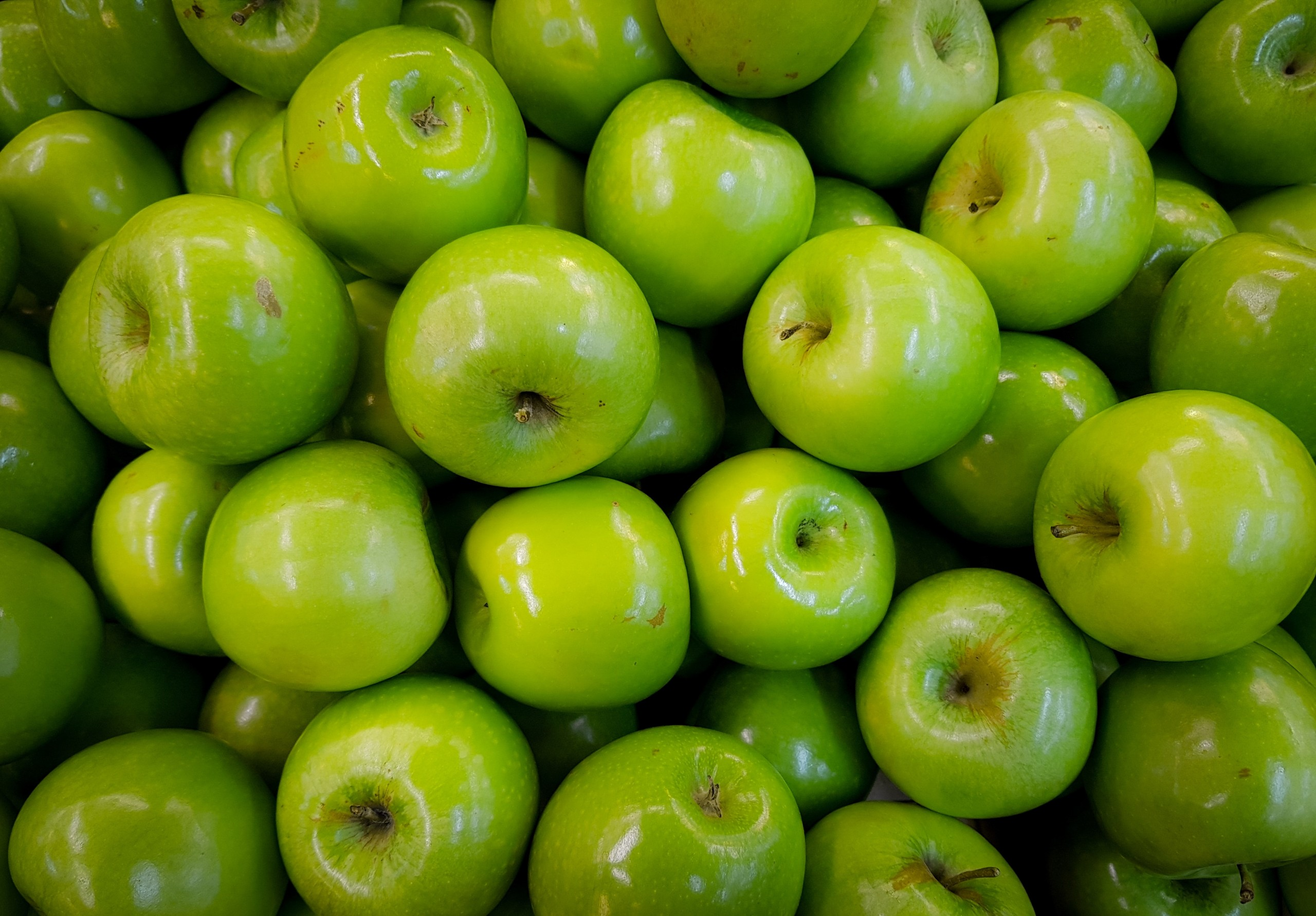 Pile of Granny Smith Apples.