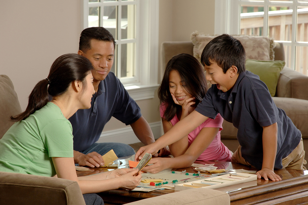 Family plays a board game together.