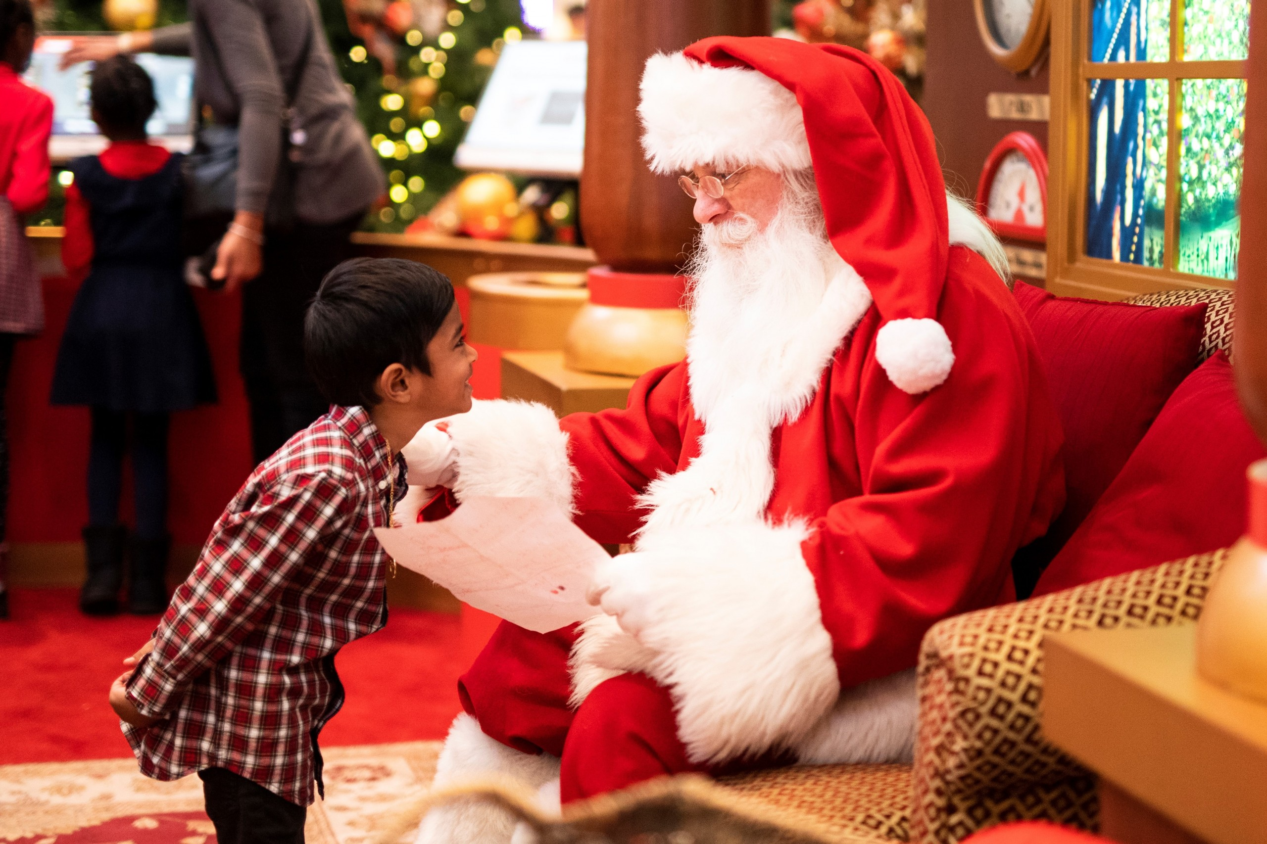 Child visits with Santa Claus.