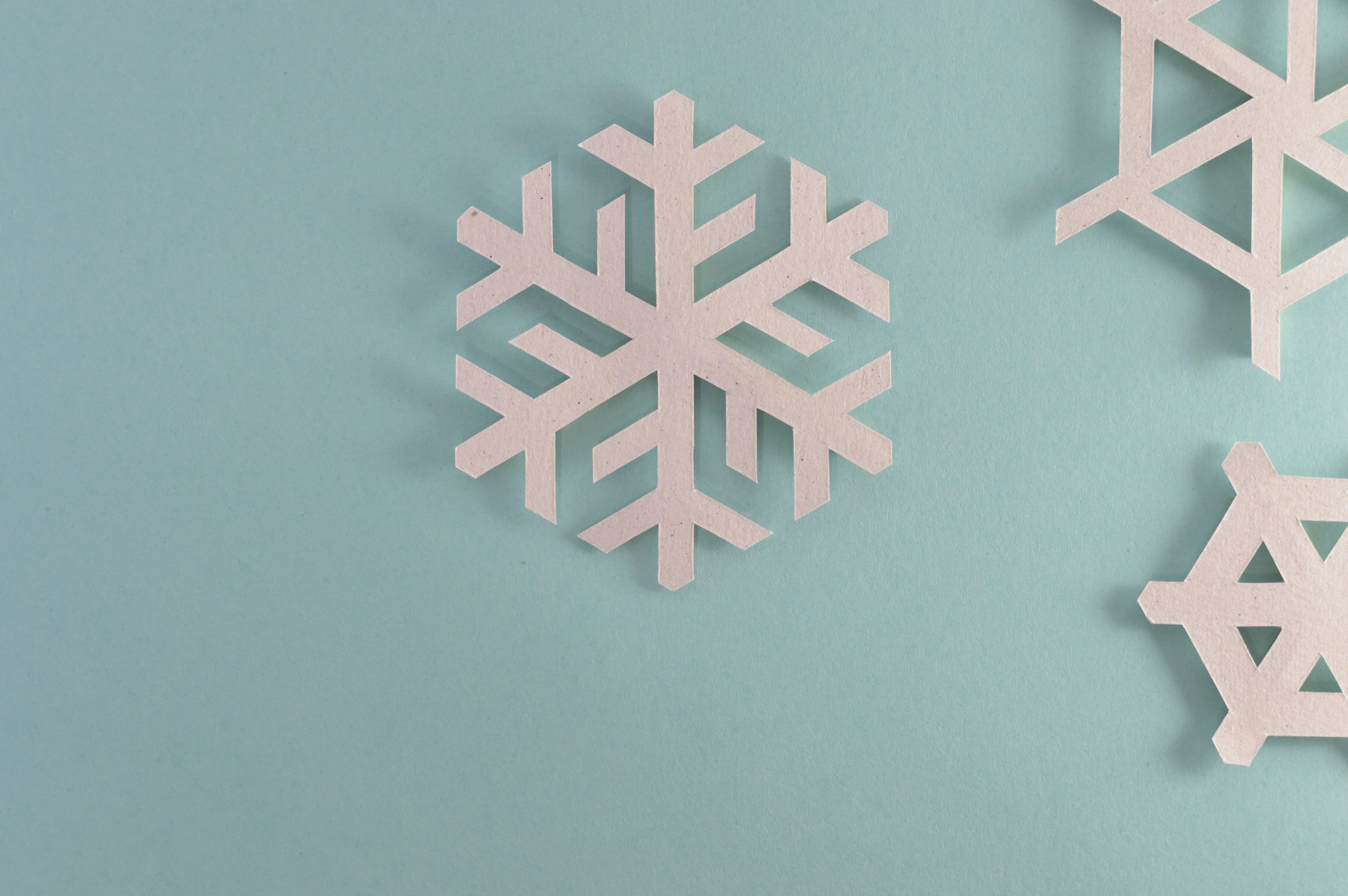Paper Snowflakes on light blue background.